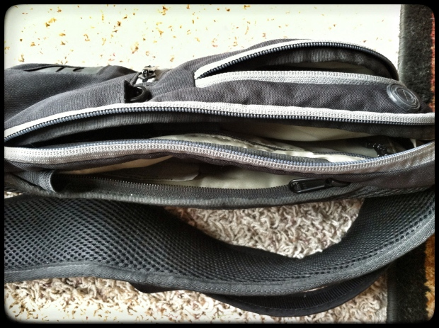 LOTS of pockets, for being such a small, compact bag!